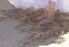 Bridesmaid feet in the sand Royalty Free Stock Image