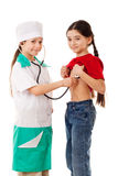 Little girl as doctor are listening a girl Stock Photos
