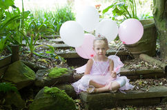 Little girl as a fairy-tale ballet princess. Little girl dressing up as a fairy-tale ballet princess on her birthday in forest garden stock photos