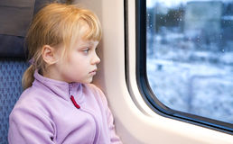 Little girl as a passenger of high speed train Royalty Free Stock Photos