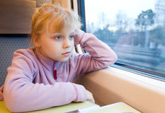 Little girl as a passenger of high speed train Stock Image