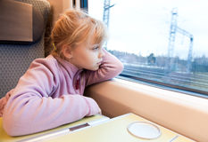 Little girl as a passenger of high speed train Royalty Free Stock Photography