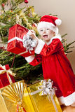 Little girl as Santa Claus Stock Photo