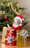 Little girl as Santa Claus Stock Photos