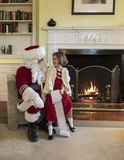 Little girl asking Santa Clause for gifts Royalty Free Stock Photos