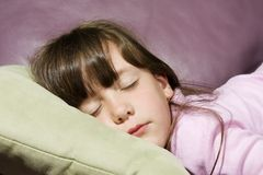 Little girl asleep on couch Stock Photo