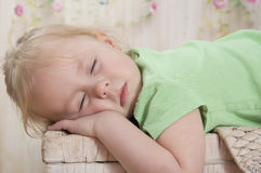 Little girl asleep. Cute little girl lying with closed eyes Stock Images