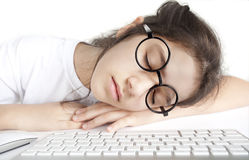 Little girl asleep in front of the computer Royalty Free Stock Image