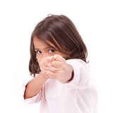 Little girl assuming stance, practicing martial arts, self-defen. Se, kungfu, karate, boxing, white isolated background Stock Images