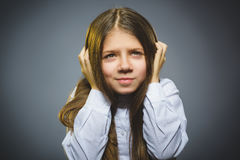 Little girl with astonished expression while standing against grey background royalty free stock photography