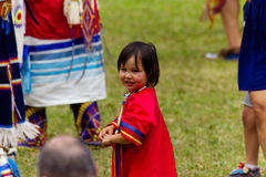Native American Little girl attending the Pow Wow in Kahnawake-Stock photos. Kahnawake, Quebec, Canada - July 9, 2017 : Pow Wow elder men dancers take part in royalty free stock photography