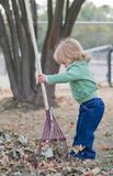 Little Girl in Autumn Stock Images
