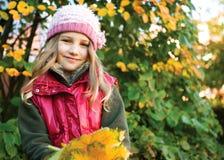 Little girl in autumn stock photography