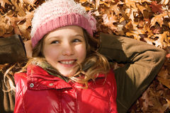Little girl in autumn Stock Photos