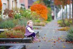Little girl in a autumn city street Royalty Free Stock Photos