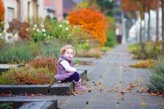 Little girl in a autumn city street Royalty Free Stock Photos