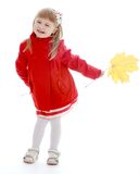 Little girl in autumn coat holding a maple leaf Royalty Free Stock Photo