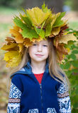 Little girl in autumn crown Stock Image