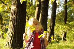 Little girl in the autumn forest Stock Photography