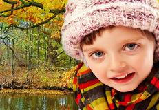 Little girl in autumn forest Stock Image