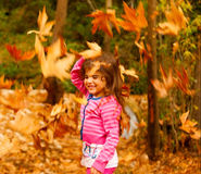 Little girl in autumn forest Royalty Free Stock Photography