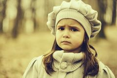 Little girl in autumn forest royalty free stock photos
