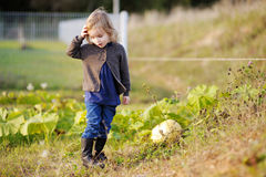 Little girl at autumn garden Stock Image