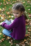 Little girl in the autumn Royalty Free Stock Photo