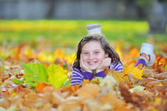 Little girl on autumn stock images