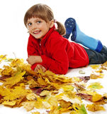 Little girl and autumn leaves Stock Image