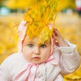 Little girl among autumn leaves Royalty Free Stock Image