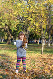 Little girl with autumn leaves Stock Image