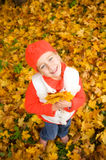 Little girl with autumn leaves outdoors Royalty Free Stock Photo