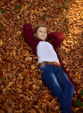 Little girl in autumn Royalty Free Stock Image