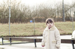 A little girl in autumn Royalty Free Stock Images