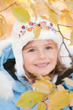 Little girl in autumn park Royalty Free Stock Photos