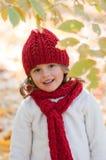 Little girl in autumn park Stock Images