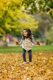 Little girl at  autumn park Royalty Free Stock Images