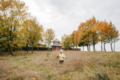 Little girl in the autumn park.with a bouquet of leaves.castle.f Stock Photo