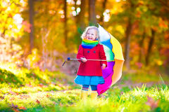 Little girl in an autumn park Stock Images