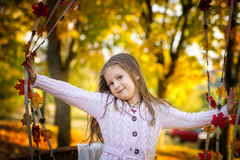 Little girl in the autumn park Stock Photos