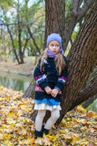 Little girl in autumn park outdoors Royalty Free Stock Photo