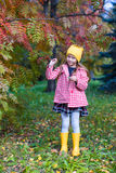 Little girl in autumn park outdoors Royalty Free Stock Images