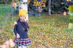 Little girl in autumn park outdoors Royalty Free Stock Photography