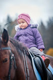 Little girl sitting on horse Royalty Free Stock Image