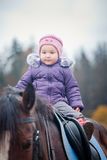 Little girl on horse Stock Photo