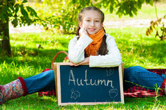 Little girl in autumn park Stock Images