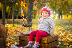 Little girl in the autumn park Royalty Free Stock Image