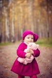 Little girl in autumn park Stock Photos