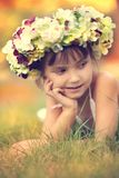 Little girl in autumn wreath of flowers Royalty Free Stock Image